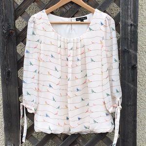 Sara Michelle beautiful cream blouse w/bird design